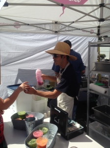 Ross Chan offers up samples of The Dig beet juice.
