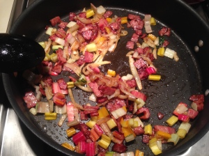 Step 4: Add chard stems while bacon is browning.