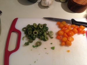 Prep Step: Halve tomatoes and slice olives.