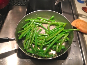 Step 1: Saute green beans and garlic.