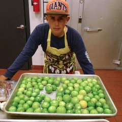 Tre Sorenson prepping tomatillos for his dad